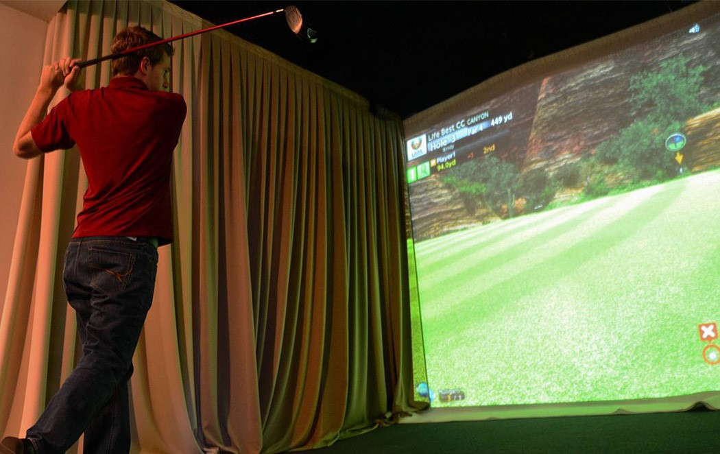 Practice Your Swing All Winter Long with a Home Golf Simulator